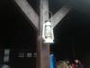 Pożegnanie słońca symboliczna lampa naftowa